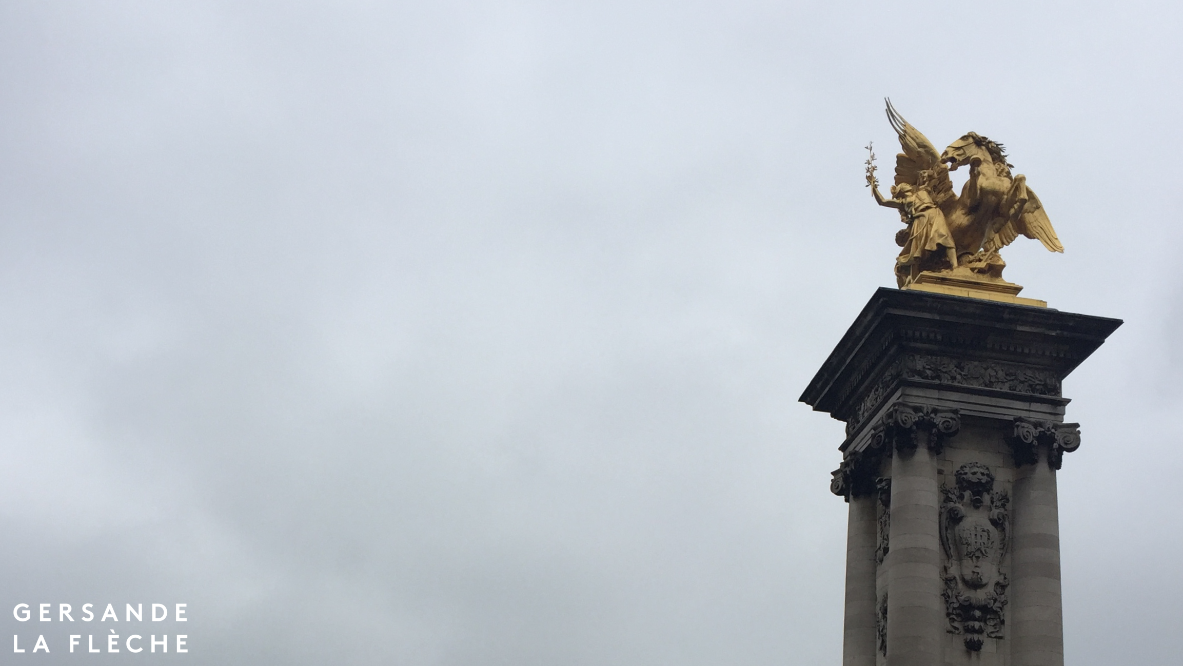 A picture of one of the statues from Pont de la Concorde set against the grey November sky.