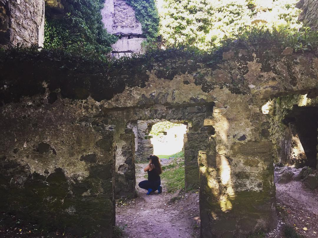 A photograph of the author taking a photograph inside an old castle ruin outside of Menlo, Ireland.