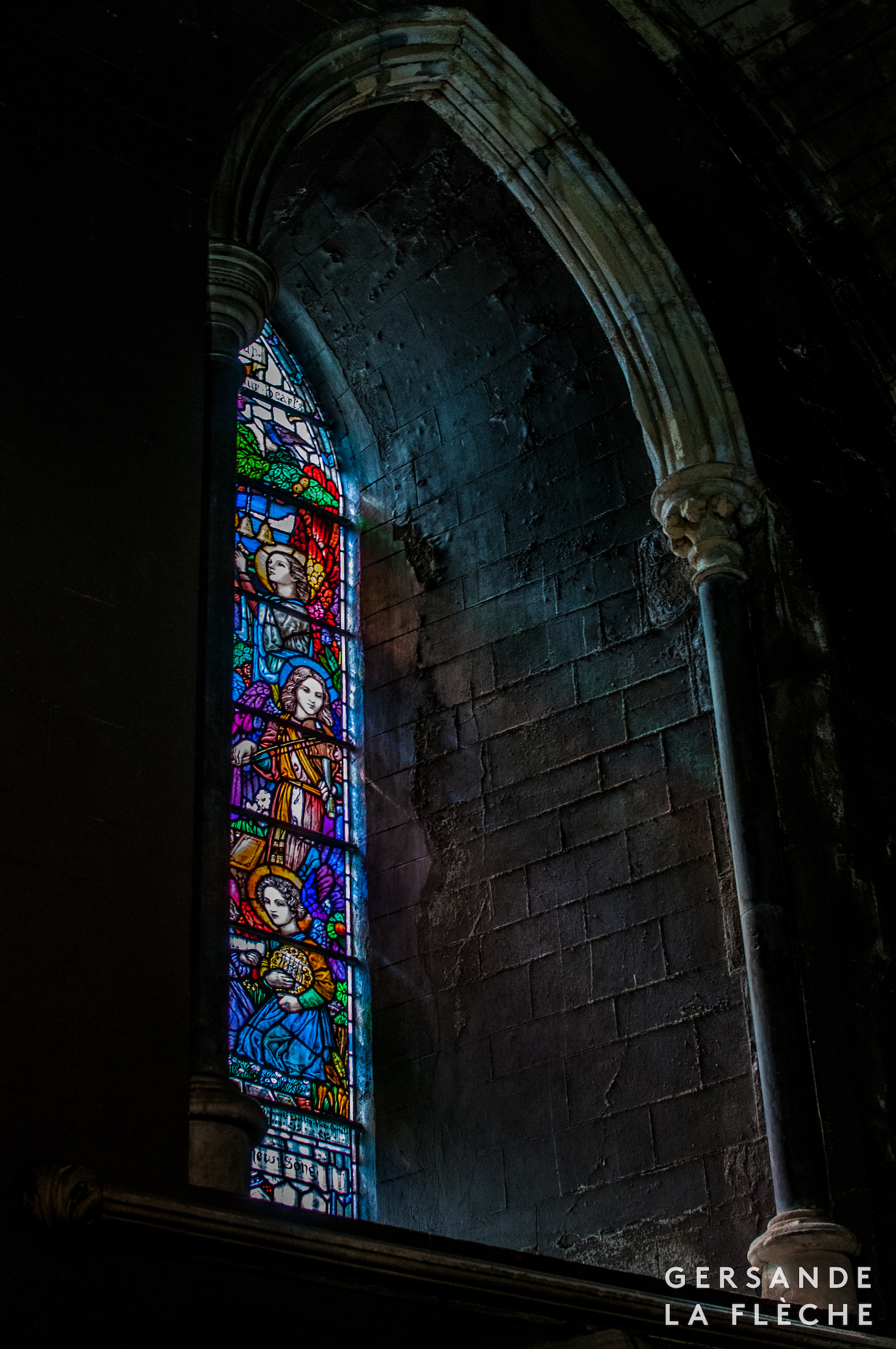 A photo by the author of a stained glass window inside St Patrick's cathedral.