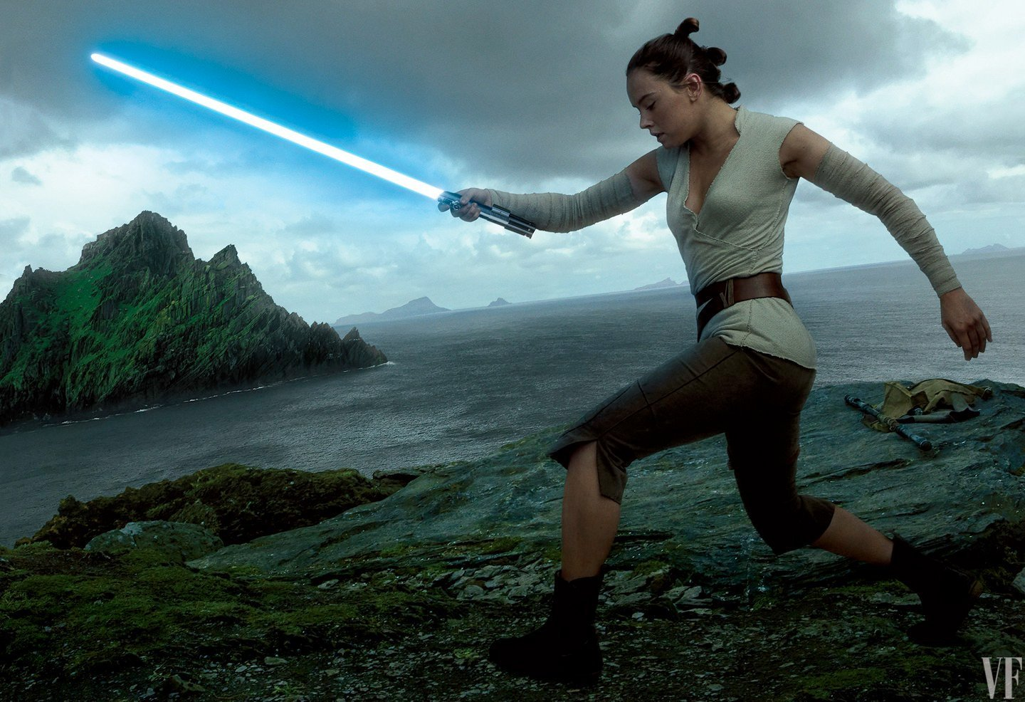 A photo of Daisy Ridley wielding a lightsaber as Rey, against the backdrop of oceans and islands, by one of my favourite photographers of all-time, Annie Leibovitz.
