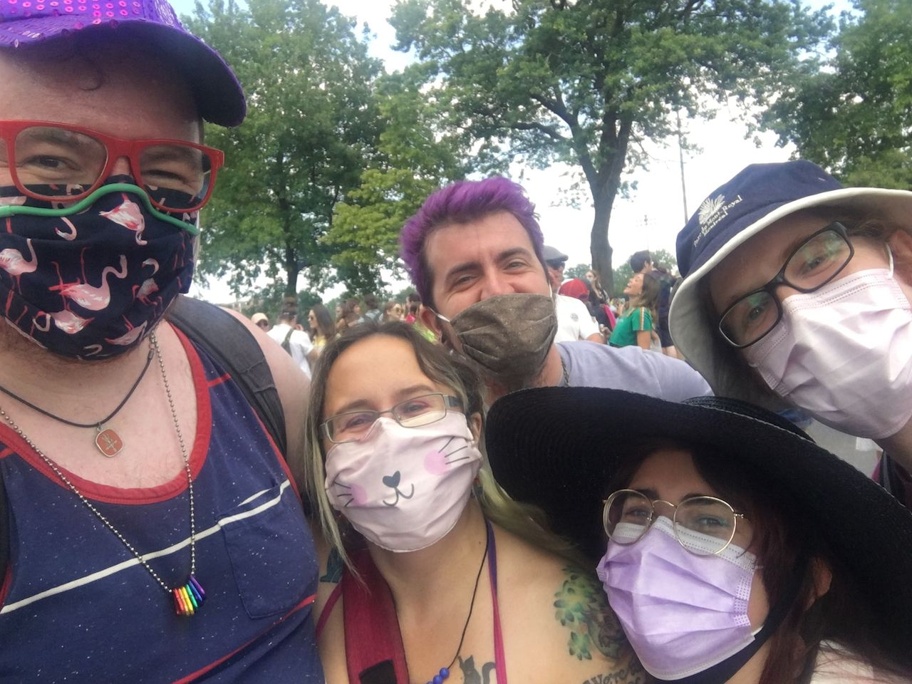 A photo of me and four friends, all masked, waiting for the Pride march to start on Avenue Parc.